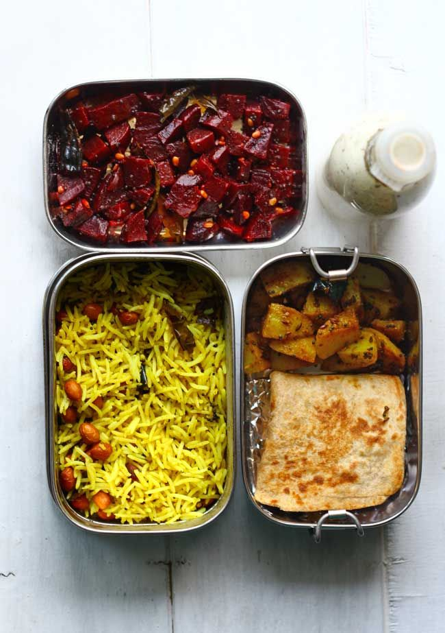 South Indian Flavors For The Office Lunchbox Lemon Rice Beetroot Poriyal Potato Masala And Paratha With Buttermilk In This Cute Little Bottle