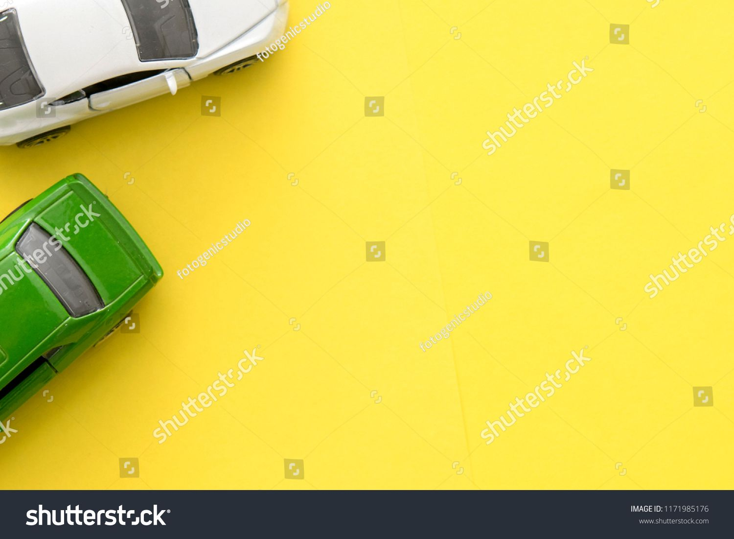 miniature toy cars on the yellow background top tomobile and transportation concept