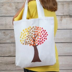 Add some beautiful fall foliage to a plain tote using your own fingers and fabric paint.