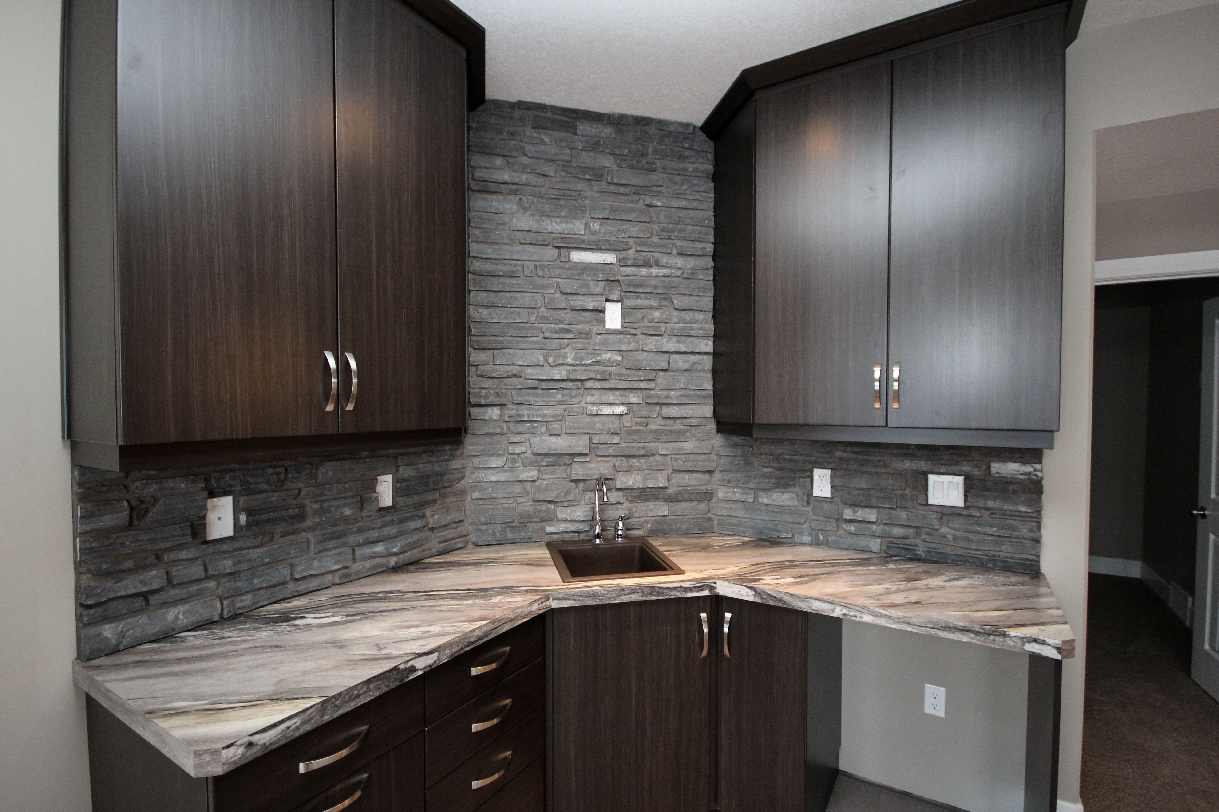 Deluxe Wet Bar In Basement Stone And Chocolate Cabinets Like The L Shape Basement Bar Basement Bar Designs Wet Bar Basement