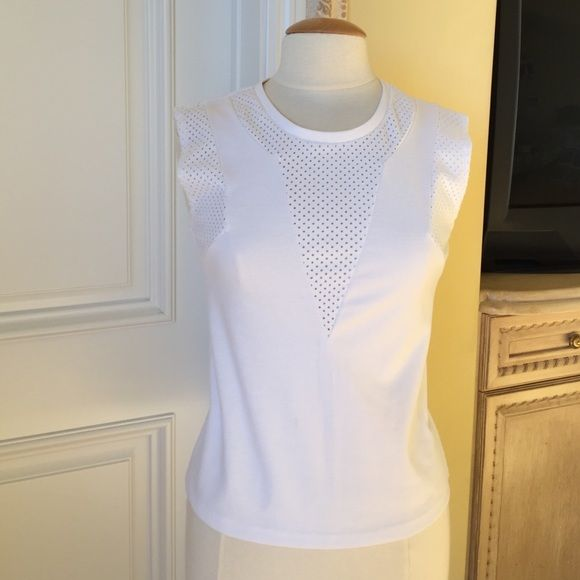 Modern sleeveless top Modern sleeveless top by Trouve. Excellent condition except for small spot in front. See third pic. Cute texture detail with cut-out dots. Trouve Tops Tank Tops