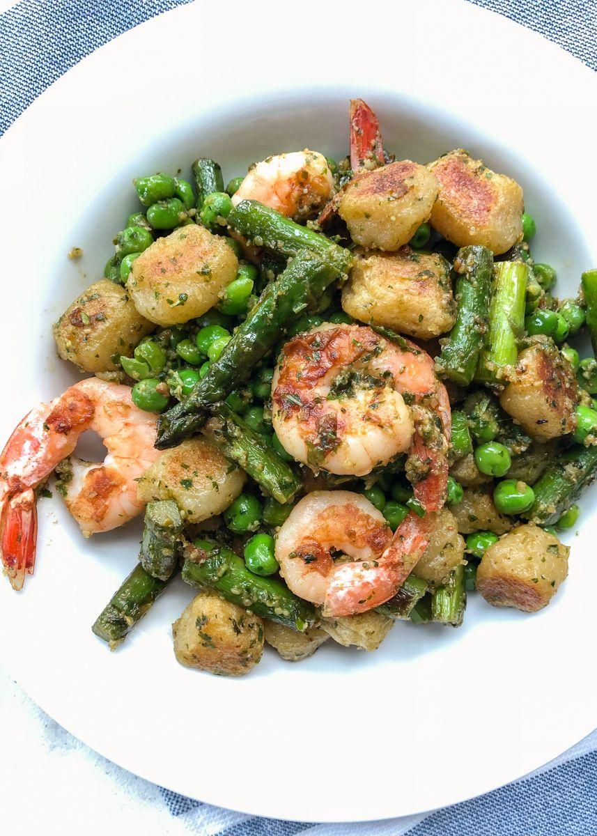 Baked Trader Joe S Cauliflower Gnocchi With Crispy Shrimp And Pesto Recipe Trader Joes Recipes Healthy Recipes Seafood Recipes
