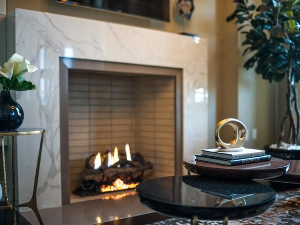 Carrara Marble Surrounds This Inviting Gas Fireplace Providing The Perfect Spot To Gath Living Room Pictures Sophisticated Living Rooms Contemporary Fireplace