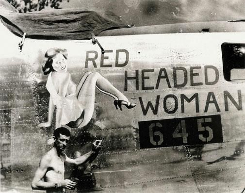 Being a Red Headed Woman, this photo caught my eye! The picture is of a B-24 named Red Headed Woman, whose distinctive nose art had been painted during WWII.