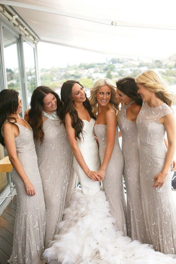Bridesmaids in sparkly, glittery dresses.