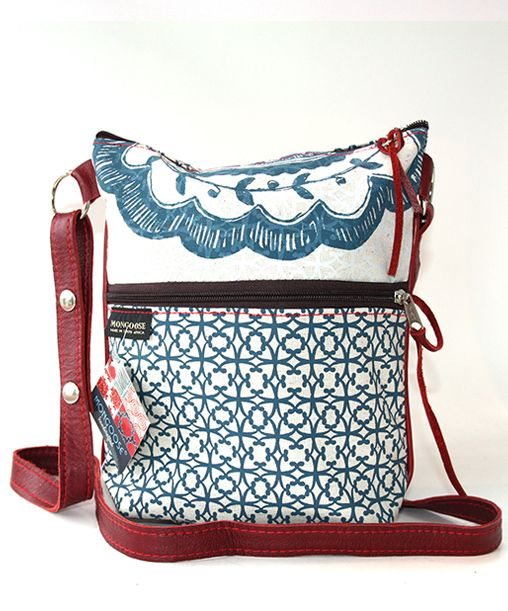 Front Leather fastener with buckle Cotton lining One small inside pocket  25 cm width  41 cm height  12 cm depth  Back Straps