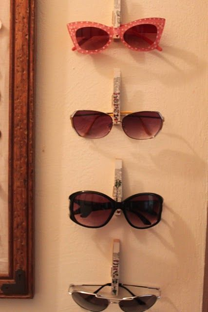 Clothes pins as sun glasses holders