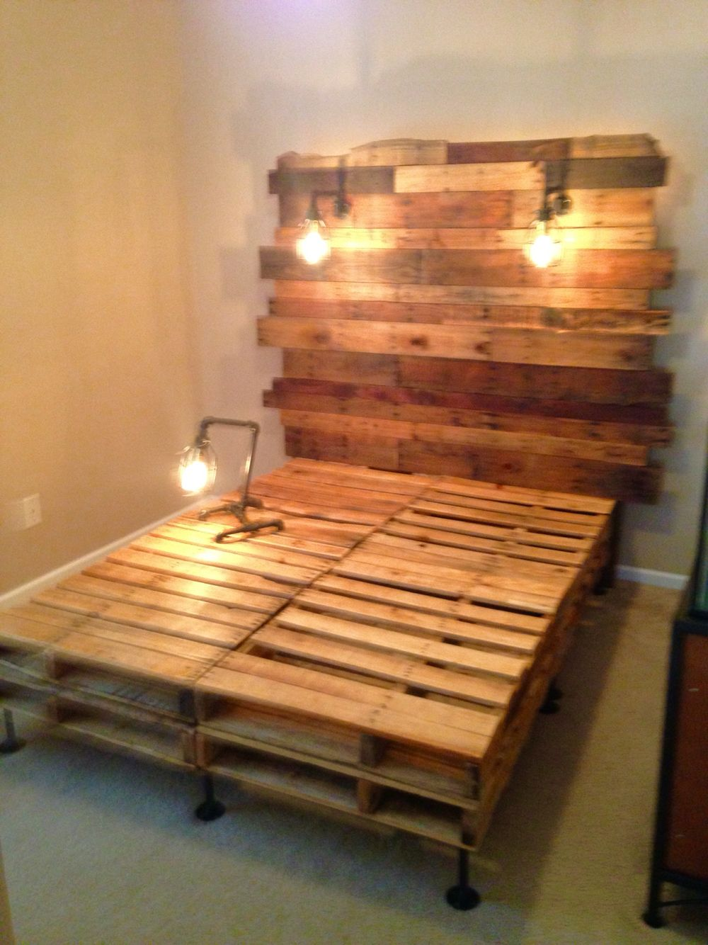 Pallet bed with Edison builds and birdcage light frames | Repurposed ...