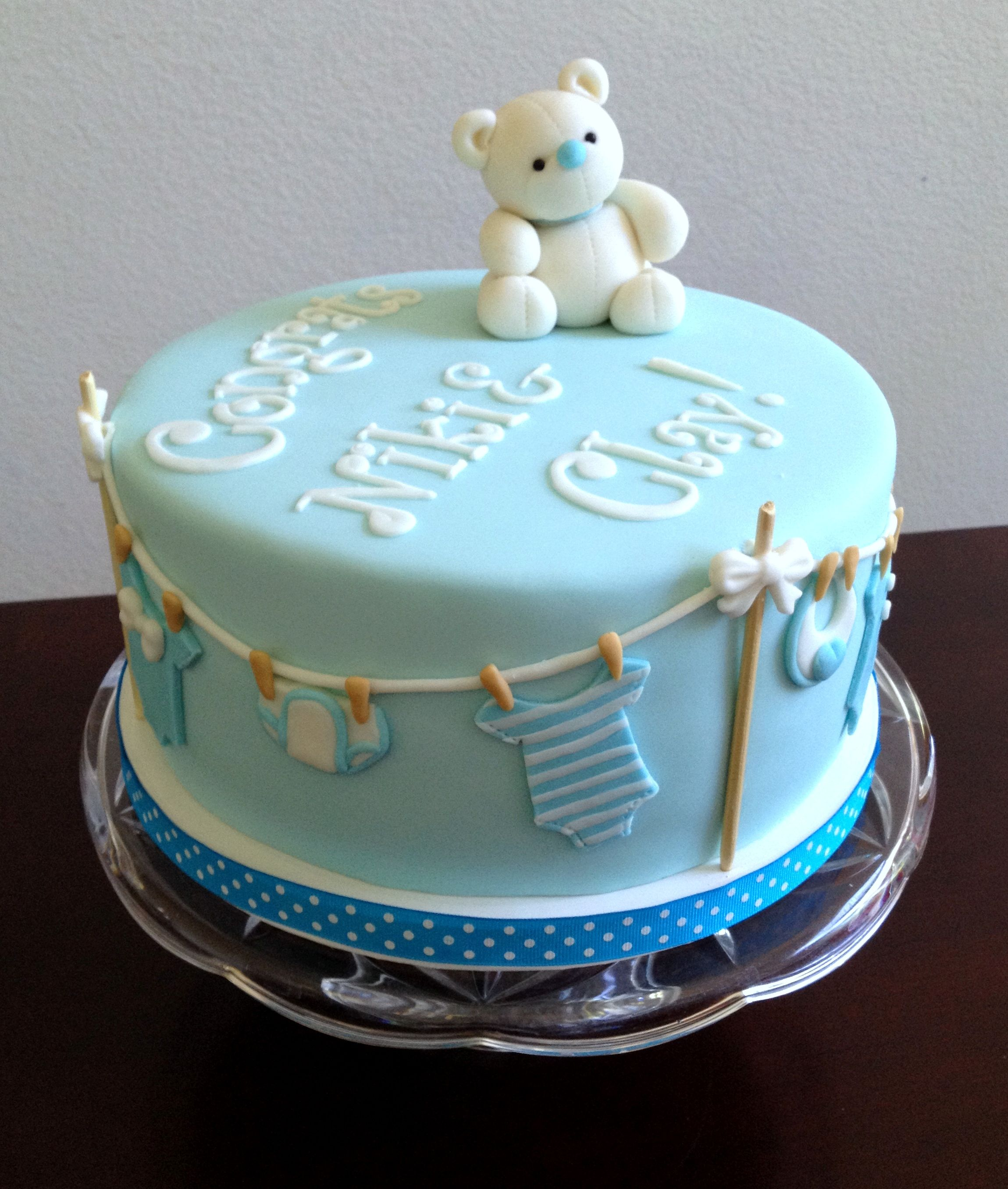 Baby Boy baby shower cake. Skewers for clothe line poles. Topper and all  cake details made from Marshmallow Fondant.