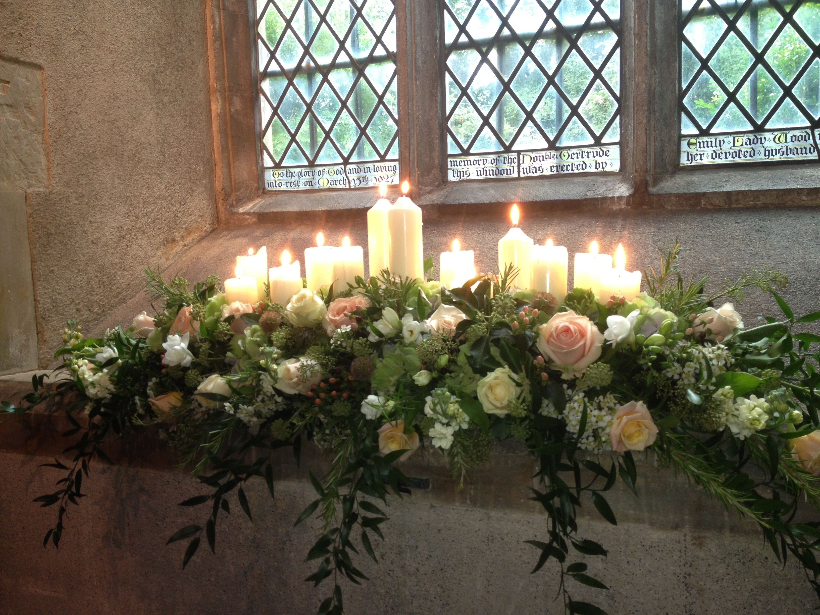 Windowsill Dressed With Candles And Cascading Flowers Church Flowers Church Wedding Flowers Wedding Candles Church