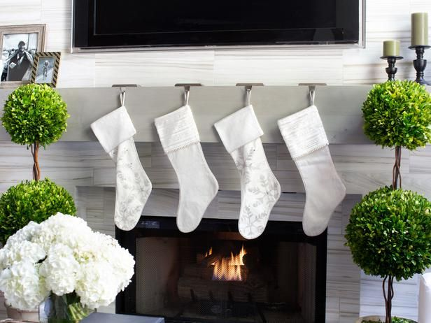 10 Remodeling Projects to Do Before the Holidays : Decorating White and Silver Stockings in a Chic Modern home.