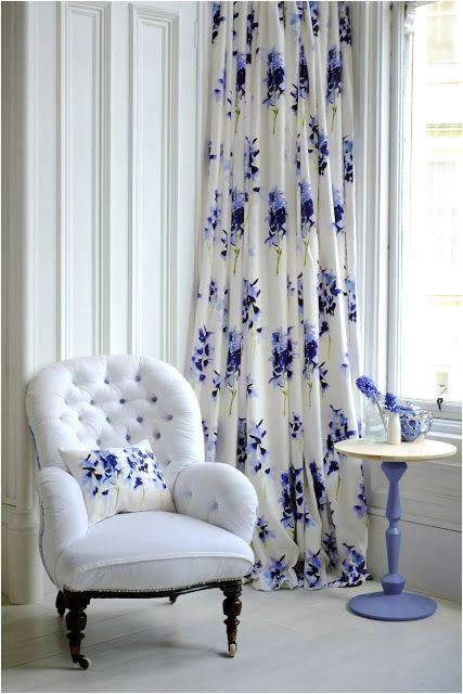 White Chair With Lovely Blue Floral Curtain. BluebellgrayLiving Room ...