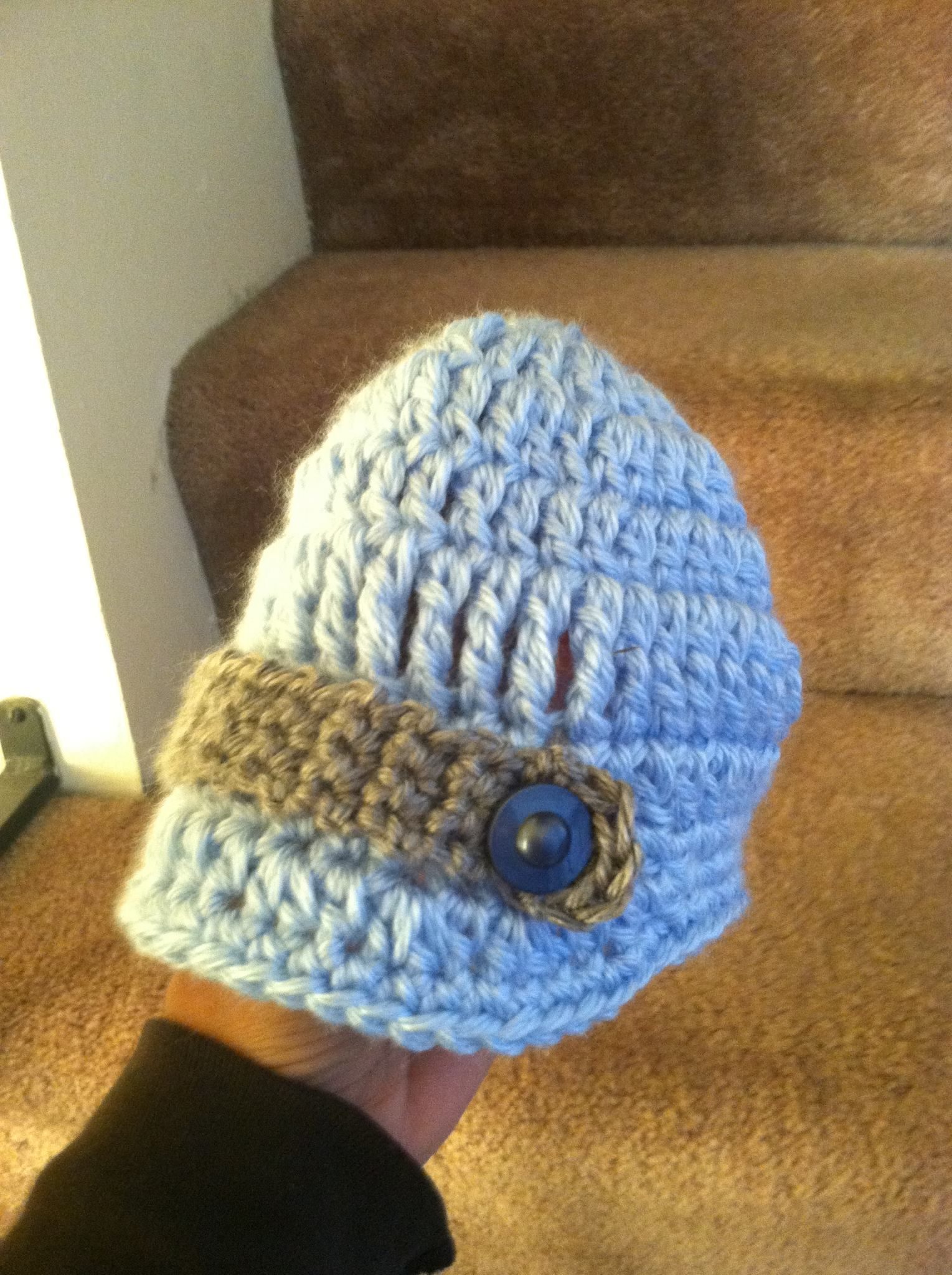 Very cute baby hat. It's blue with a grey strap and blue button on it. Very soft and warm and even has a cute little brim!