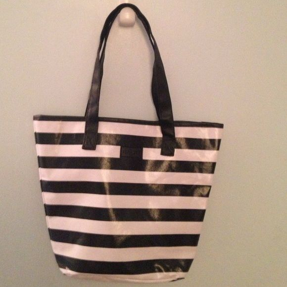 Sephora Tote Sephora tote bag, black and white striped with black handles, good condition except for a couple of spots and slight tear in one of the handles- see pics. No trades. Make offers! Sephora Bags Totes