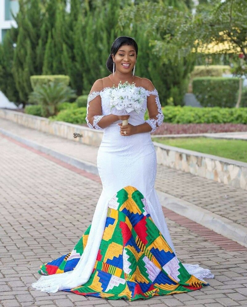 Beautiful Ghanaian Bride In White And Kente Train Wedding Gown African Traditional Wedding Dress African Wedding Attire Ghanaian Wedding [ 993 x 800 Pixel ]