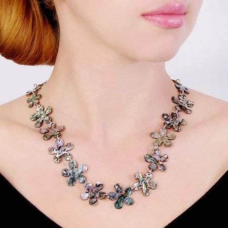 Stunning abalone shell and sterling silver combine in this flower necklace from JeGem.com
