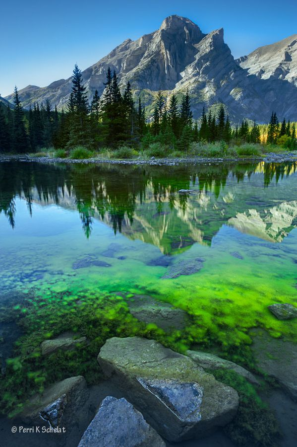 Little Tarn by Perri Schelat, Mount Kidd, Kananaskis Country, Canada. Kananaskis Country is a park system situated to the west of Calgary, Alberta, Canada in the foothills and front ranges of the Canadian Rockies.