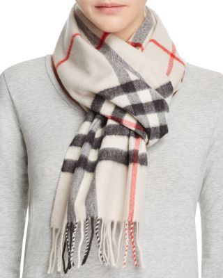 Stay warm in sophisticated style with Burberry s luxe cashmere scarf,  canvased with the design house s signature check pattern. 95ea7f13ec0