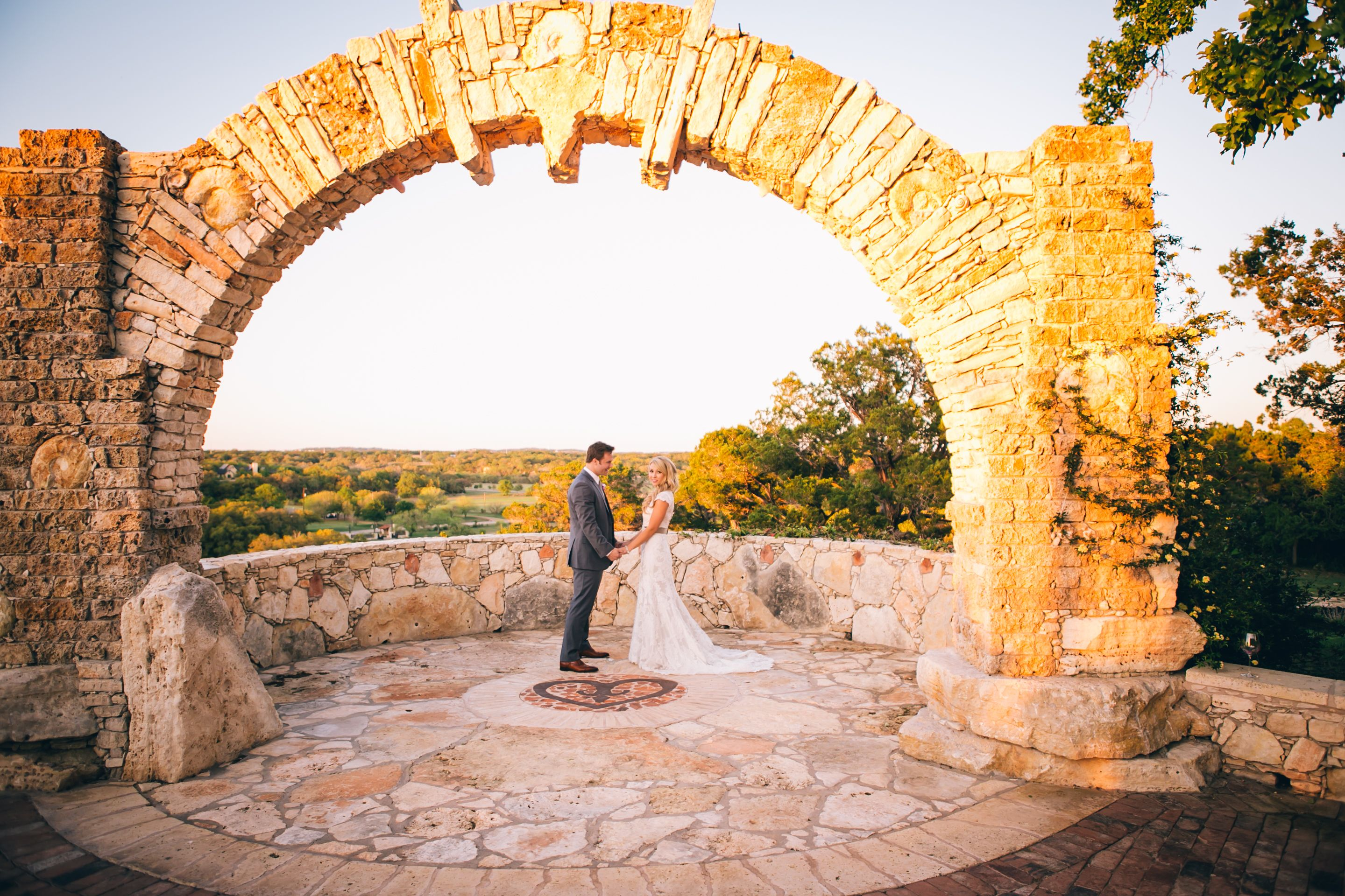 The stone arch at Ian's Chapel wedding venue at Camp Lucy