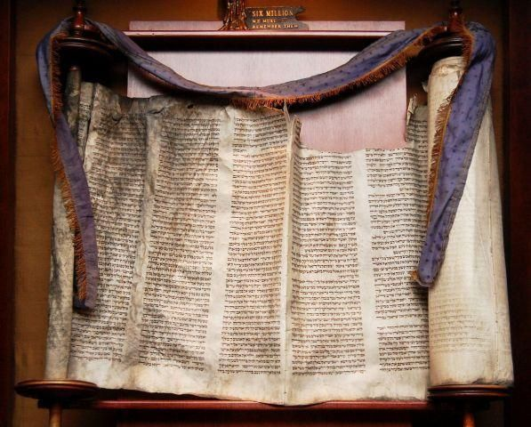 This Torah scroll at Temple Dor Dorim, Weston, is one of hundreds that were rescued after the Holocaust.