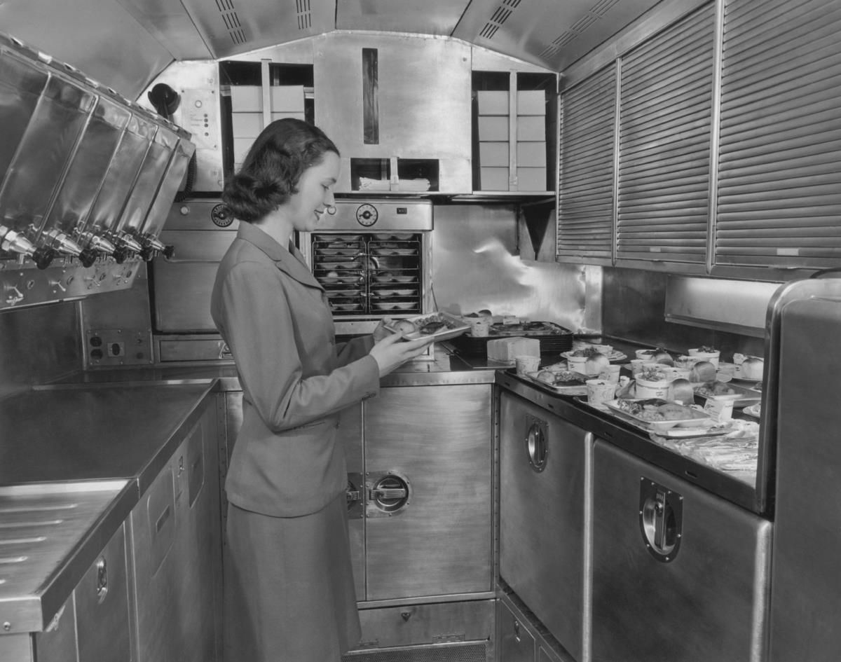 A Pan American World Airways flight attendant preparing in