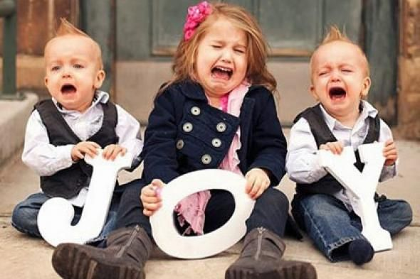 Hilarious Christmas card with three miserable crying children holding letters that spell joy