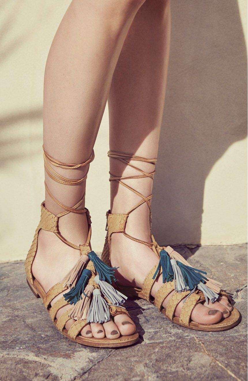 Flouncy tassels dance with every step on these snake-embossed leather sandals from Steve Madden. Loving the fresh, playful spin on a go-to gladiator silhouette.