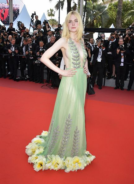 ade33a42a Elle Fanning looked like an ethereal forest fairy in this green beaded Gucci  gown featuring silk flowers at the hem.