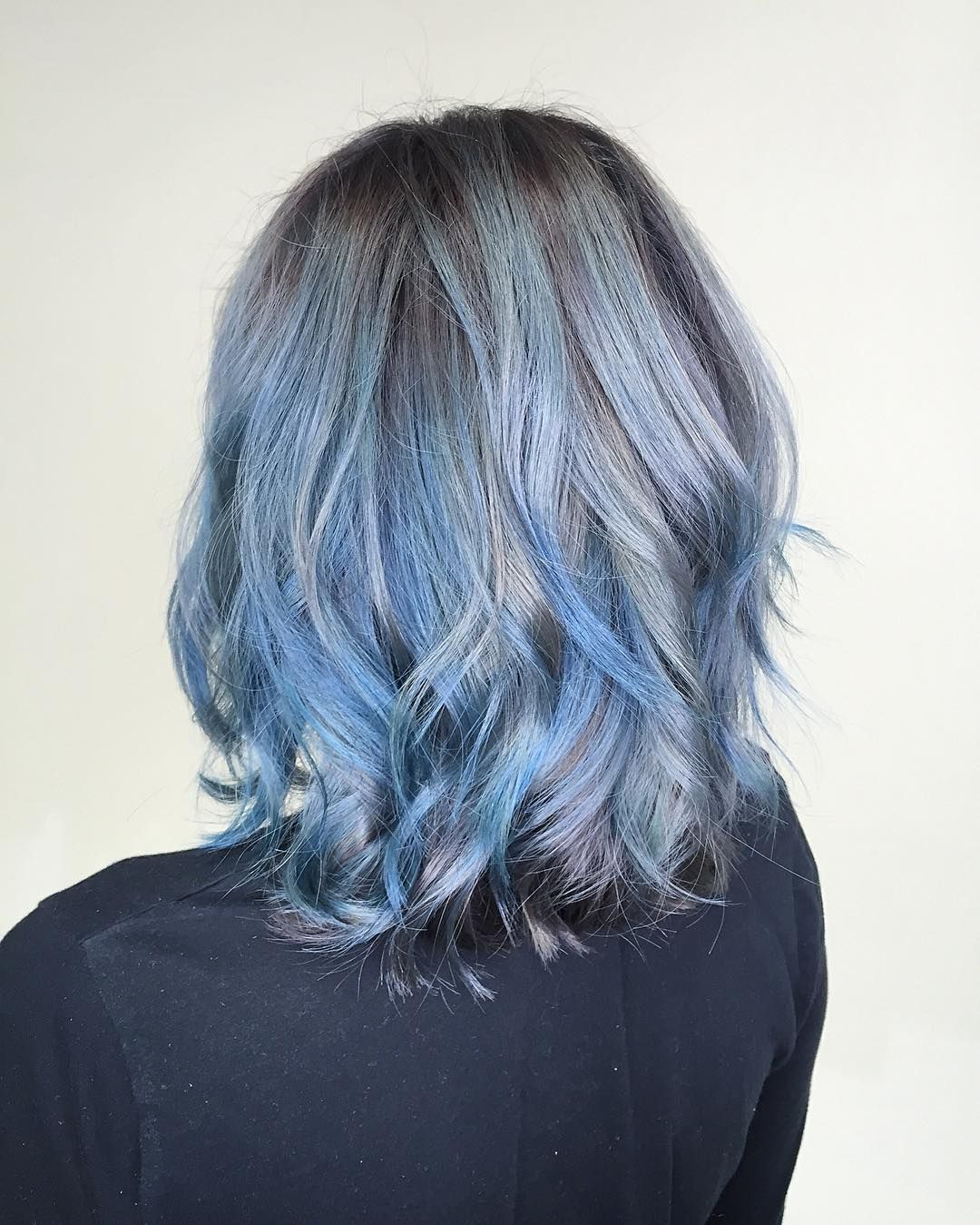 Shoulder Length Wavy Hair With Short Layers And Blue Balayage