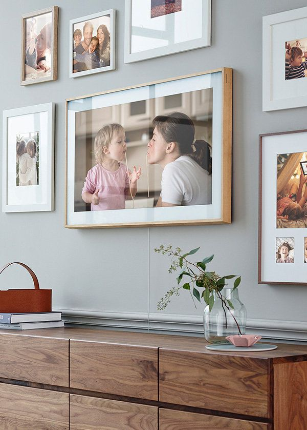 The Frame On The Wall Displaying Artwork Among Other Picture Frames Framed Tv Frames On Wall Picture Frame Tv