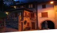 Mezzoldo, angolo della frazione di Scaluggio con le luci della sera, Alta Val Brembana
