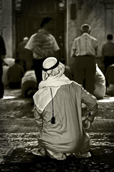 Syrian man praying