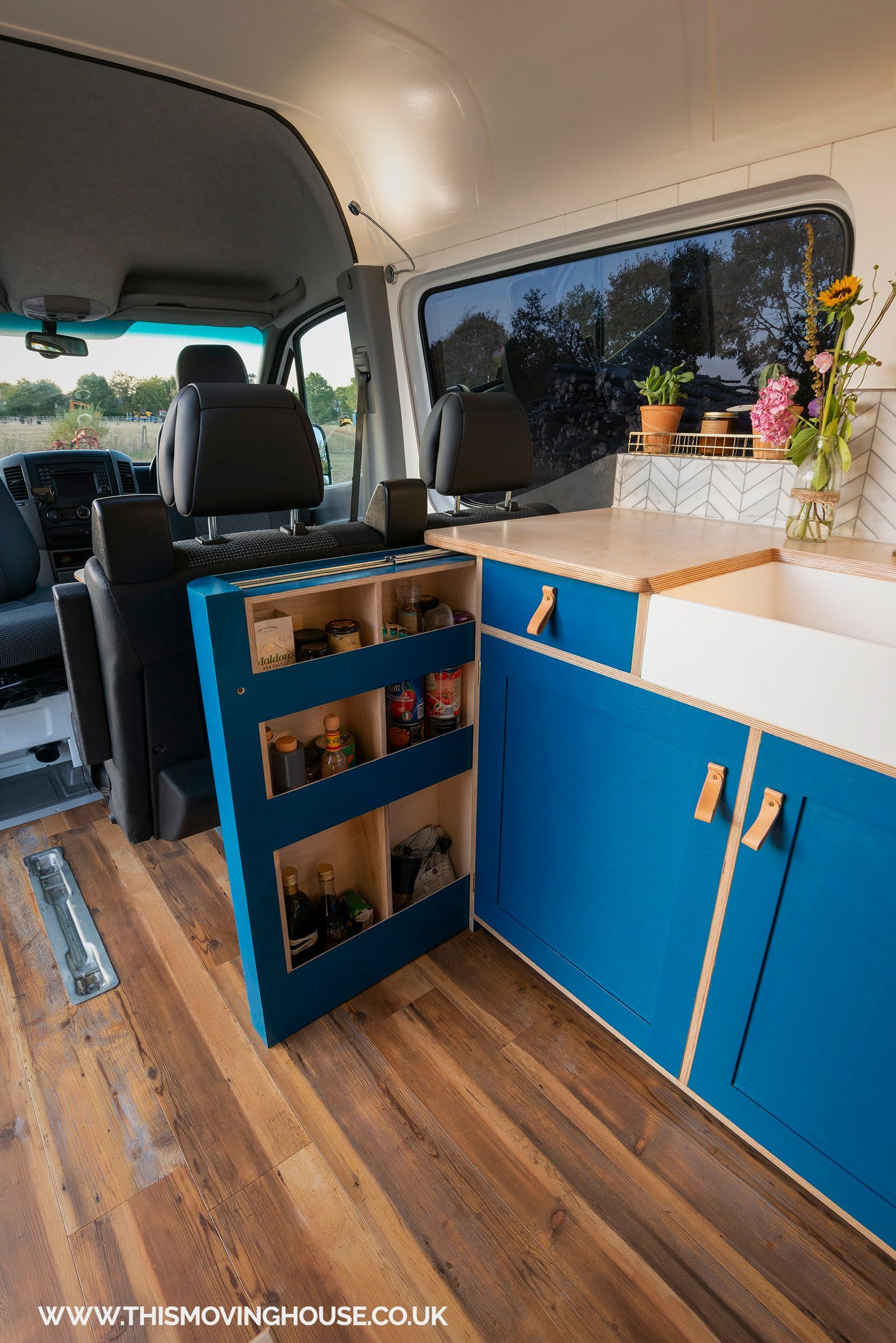 Slide out storage in a camper van kitchen with a belfast sink available from thi...  #available #belfast #camper #kitchen #slide #storage