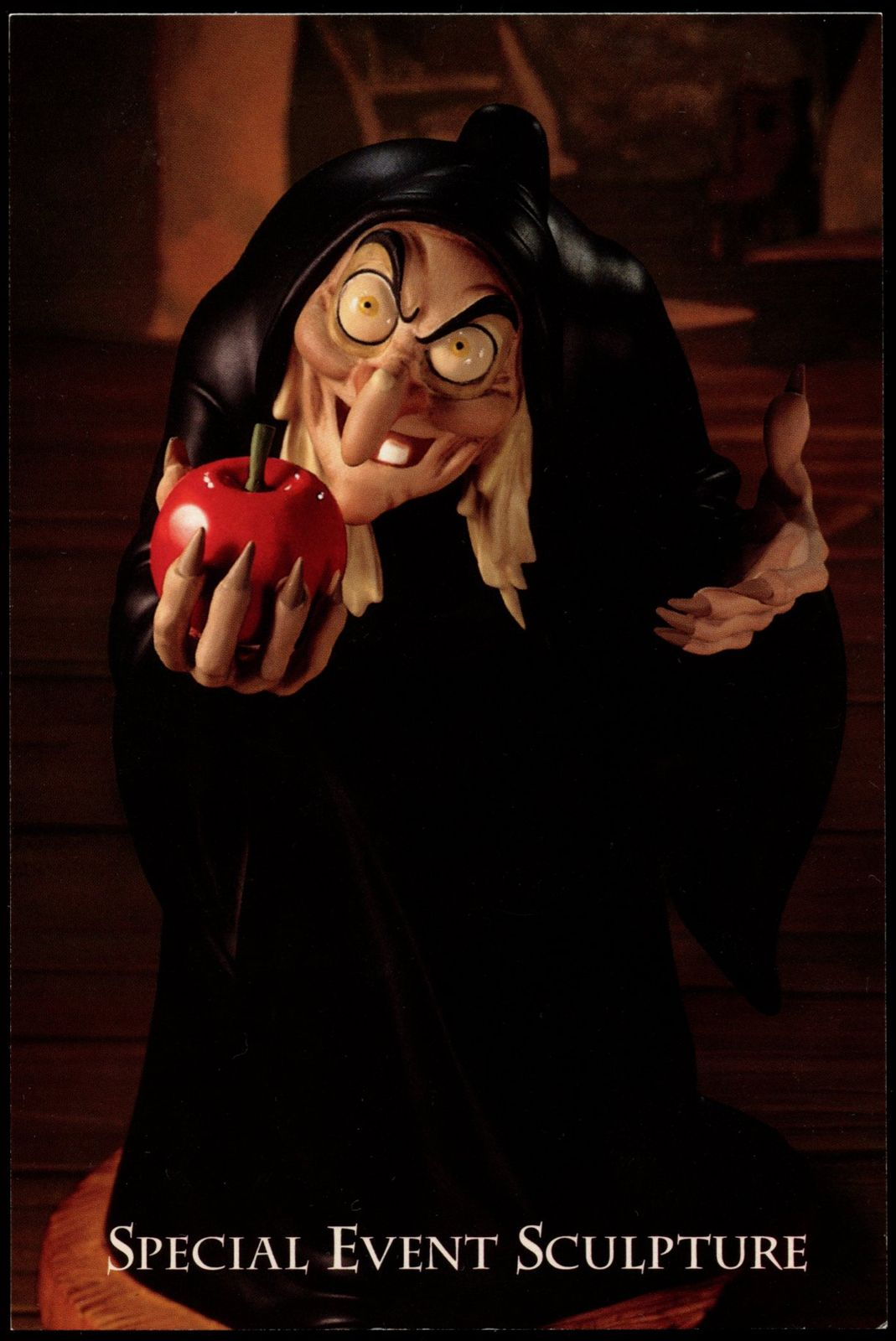 """WDCC Witch Postcard/Button Special event postcard and rectangular button from the 1995 Walt Disney Classics Collection promotion of the figurine, Take The Apple, Dearie. Postcards were mailed out to collectors by Authorized Dealers or were included in the WDCC Sketches or Newsflash mailings. Card measures 6"""" x 4"""" with a description of the figurine on backside. The button was a Gift-with-Purchase item. Measures 3.5"""" x 2"""" and has the """"© Disney"""" mark printed on back. Postcard..."""