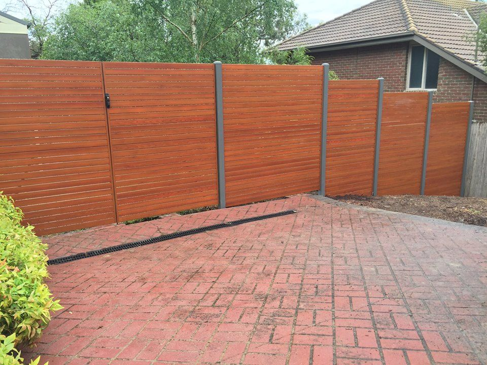 Wrap Your House Around The Best Aluminum Slat Fencing From Accolade Screens Aluminum Fence Privacy Aluminum Fence House Blinds