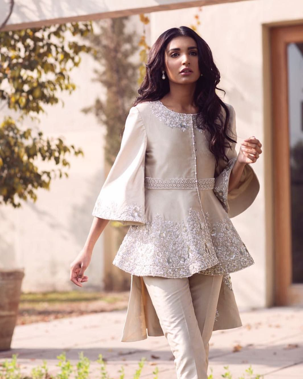 d471dad6e7d An elegant high low embellished top paired with straight cigarette pants  from Saleha Kashif s spring summer 2018 collection