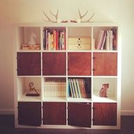 Antlers and wood doors to mix up an expedit.