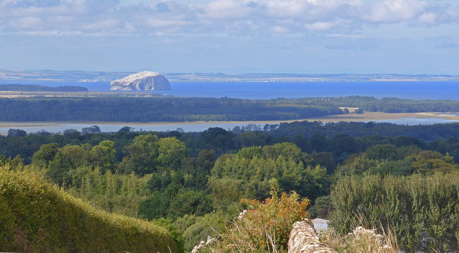 Looking down to The Firth of Forth above Dunbar with Tyninghame Bay, the Bass Rock and the coastline of The Kingdom of Fife in the far distance