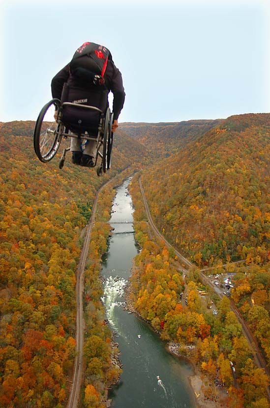 Canadian Lonnie Bissonnette jumps off the New River Gorge Bridge in his wheelchair during Saturday's 33rd annual Bissonnette is the only paraplegic BASE jumper to leap off all four objects in BASE: building, antenna, span and earth. Bridge Day in Fayetteville, West Virginia