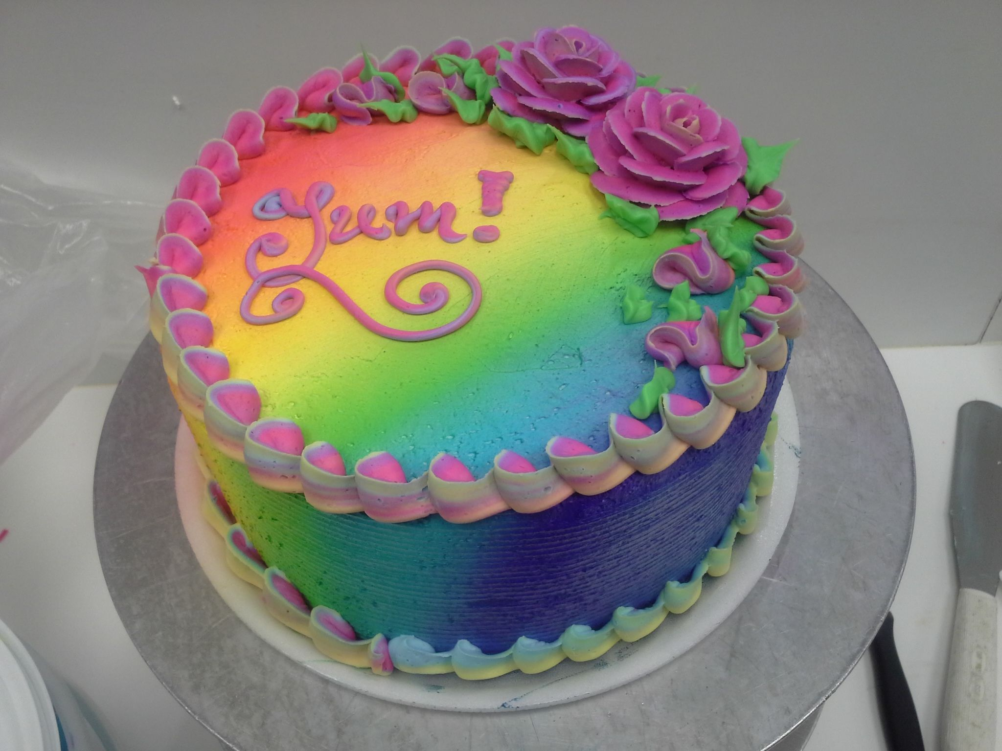 A simple twotier cake made interesting with a rainbow airbrush