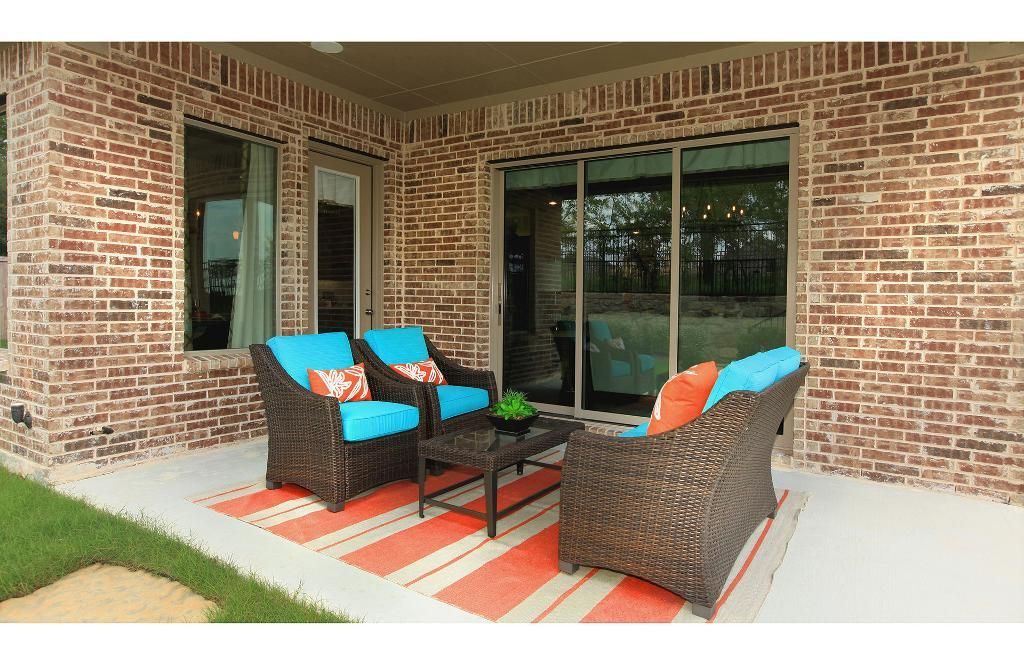 Outdoor Living Area With Patio Furniture The Parkhill Floor Plan Drees Custom Homes