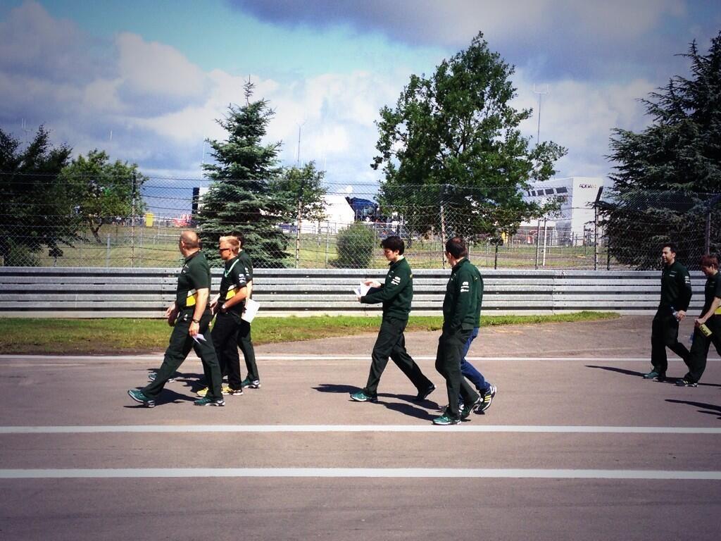 Team Caterham having a trackwalk, joined by Heikki Kovalainen - 2013 German GP, photo courtesy of Lotus F1 Team