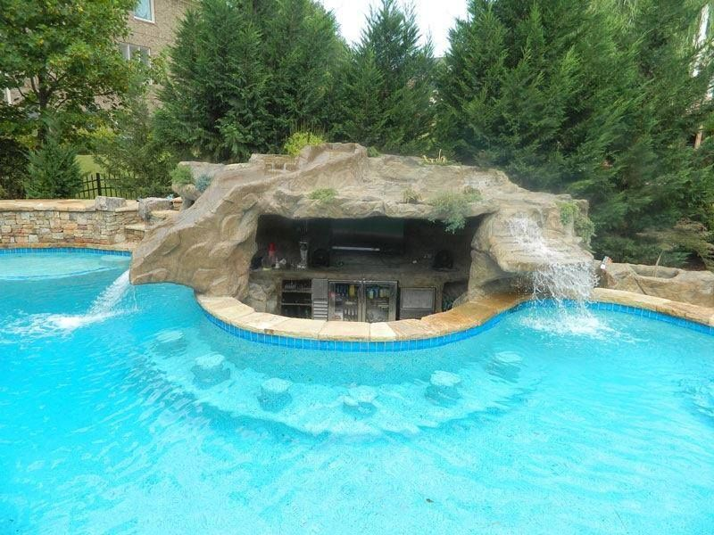 Backyard grotto design with waterfall and bar would for Swimming pool grotto design