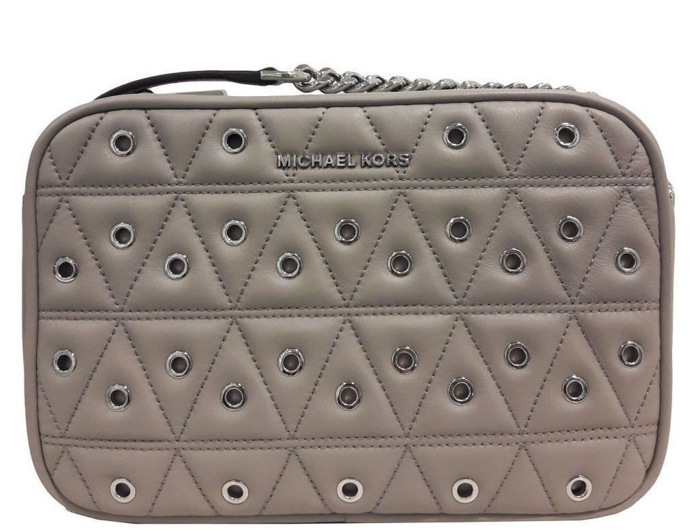 aa929b408eca Michael Kors Ginny Medium Camera Crossbody Grommet Quilted Leather Pearl  Grey 191262372988 | eBay