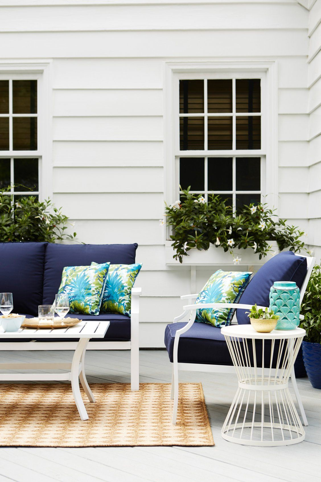 Set Sail For Style With A Nautical Inspired Outdoor Patio Set Featuring Crisp White Fram Blue Patio Furniture White Patio Furniture Patio Furniture Collection