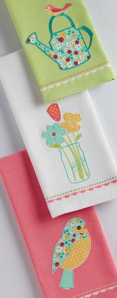 Ditzy Daisies Embellished Dishtowel. April showers bring may flowers! Cheerful floral aprons, dishtowel sets, bird embroidered tea towels, printed shopping totes, and ceramic flower pots. Perfect Spring gifts and decor for the kitchen & home. #dishtowels