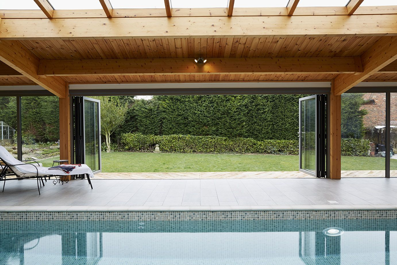 Origin Bi Fold Doors Fully Opened In A Swimming Pool Extension