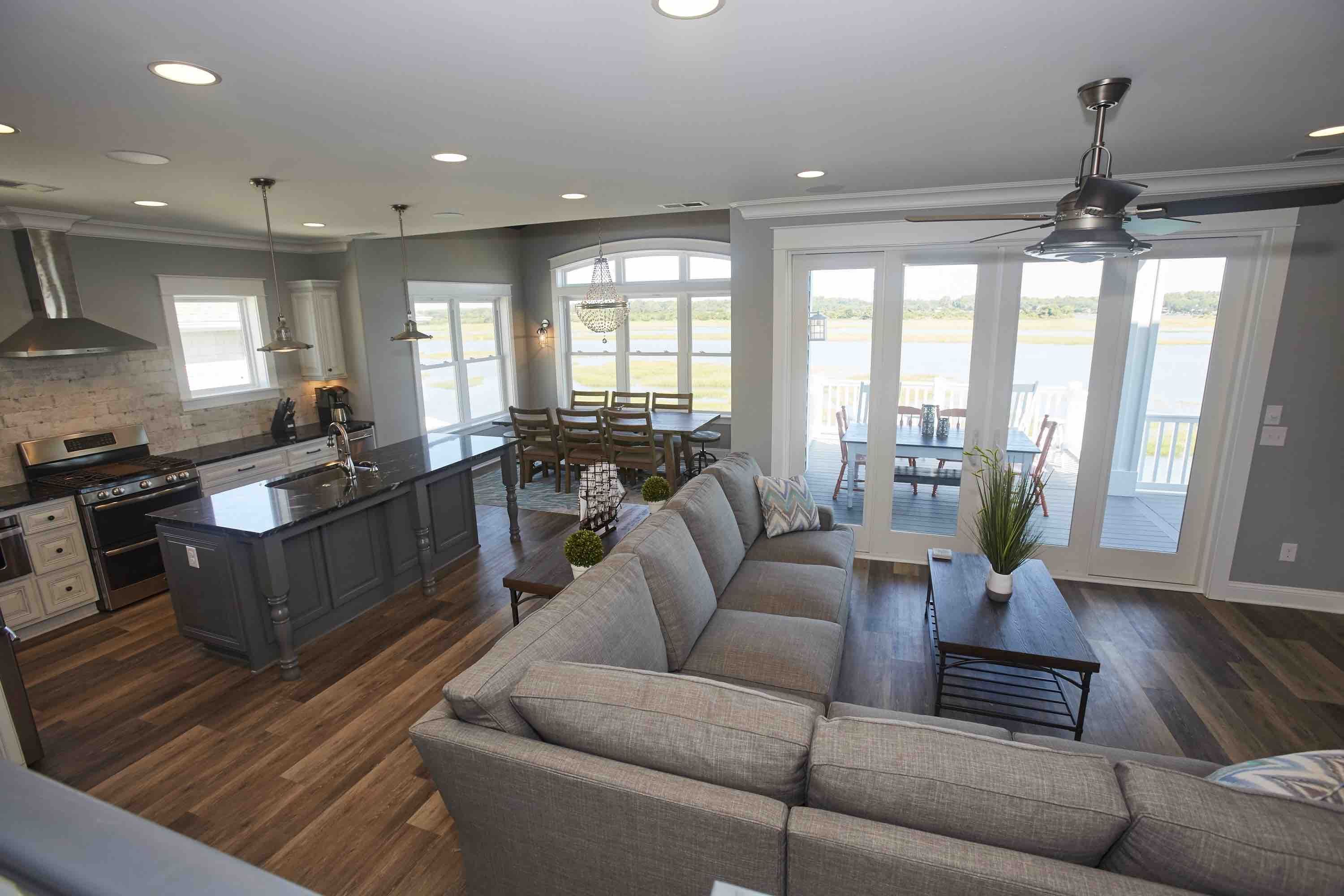 """Main Den - 60"""" flat screen TV, surround sound, plenty of seating for a crowd!  Beautiful view of the sound - you can't go wrong relaxing in this room.  #vacation #oceanisle #anyportinastorm"""