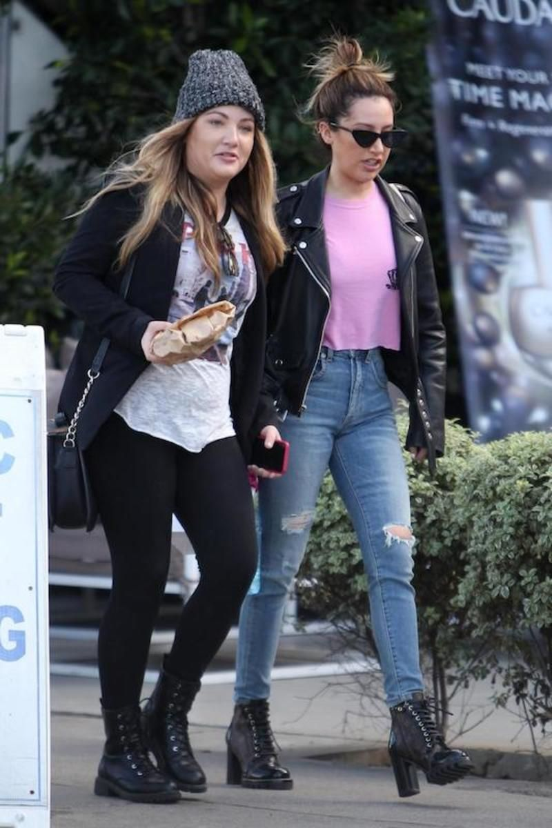 Ashley Tisdale wearing a pink graphic print tshirt, black