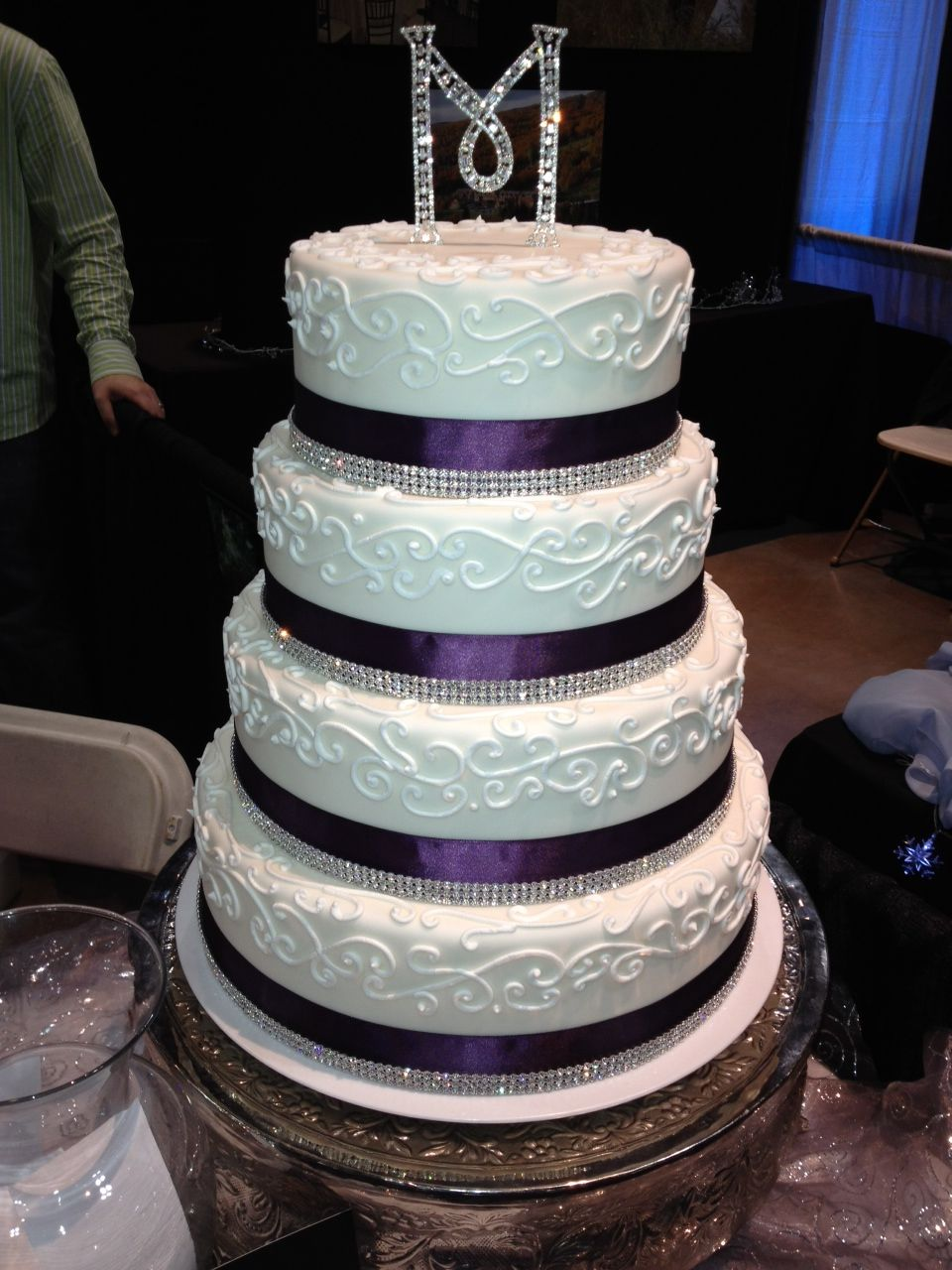 Jewel tone wedding cake um yes plum and bling